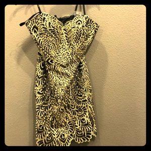 Short black and gold cocktail dress.